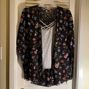 Floral shirt with a gray tank top underneath